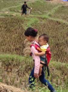 Caring for baby in the rice fields of Sapa.