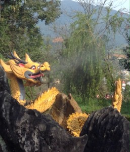 Dragon statue at the bottom of the trek breaths steam