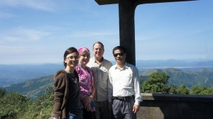 Thao, Denise, Pete, and Thao's father (Ky) at the top of Mau Son