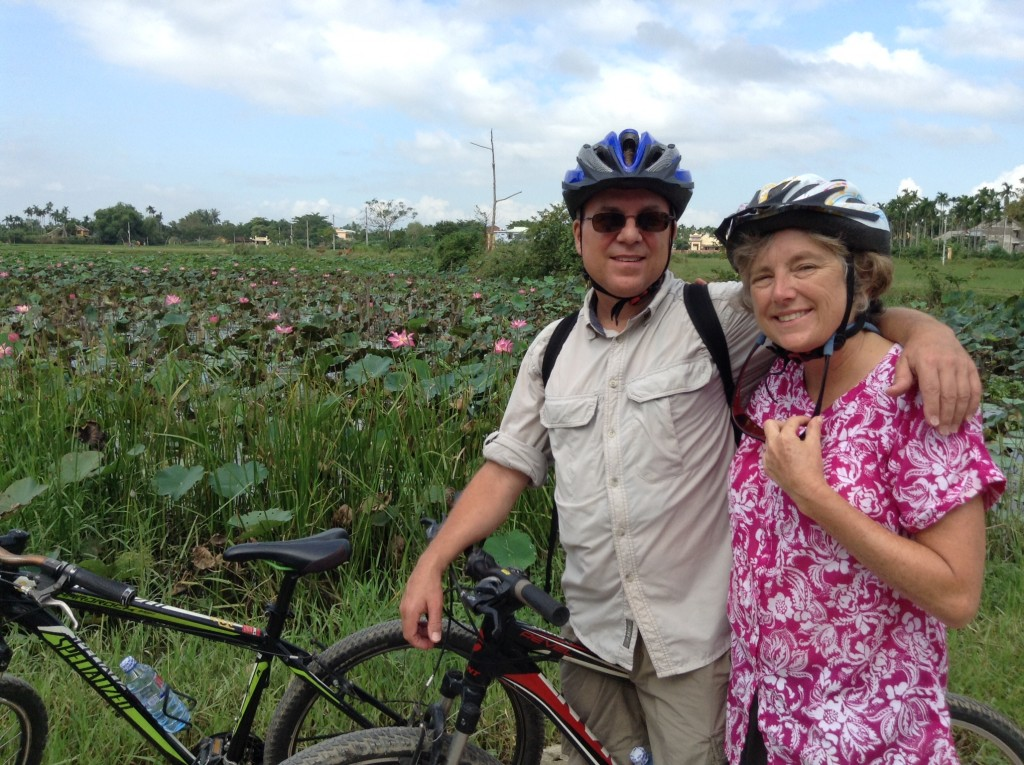 Denise and Pete in the rice paddies on bicycles!