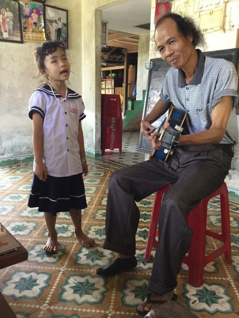 Mr. D and his daughter give a private concert.