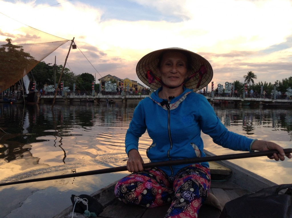 Hard working and lovely boat lady dazzles us with the river smiling all the way.