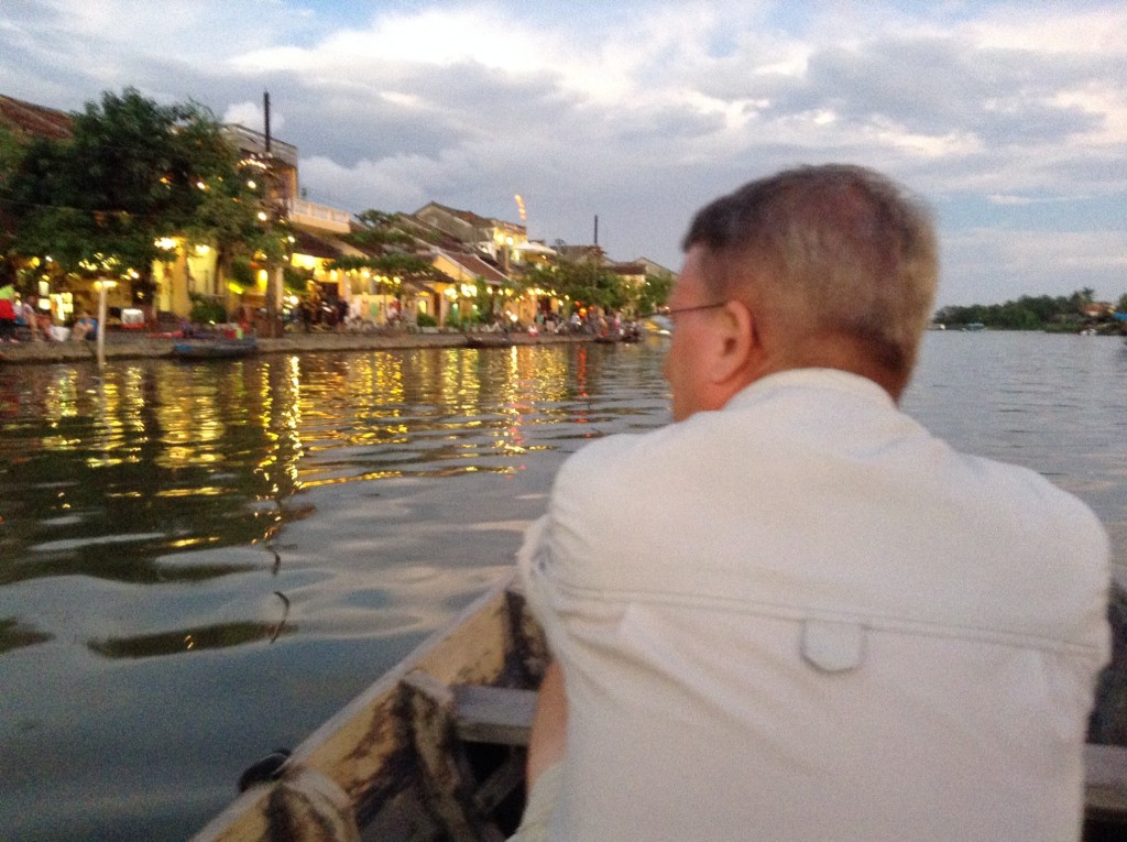 The water glistens like gold with the many beautiful lights in Hoi An.