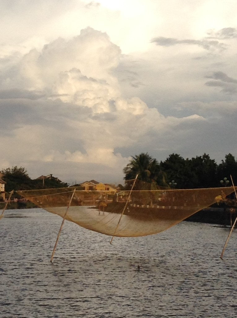 A fishing net posed above the river in old town Hoi An.