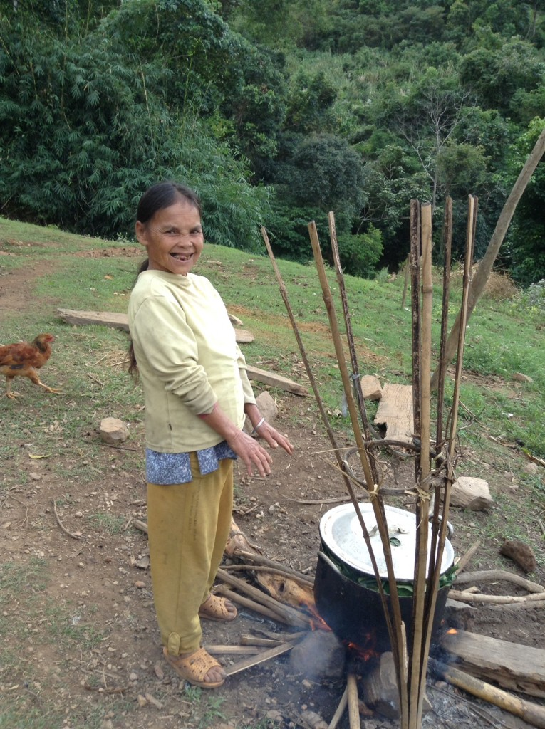The sweet lady who lives next door making food for the pigs.