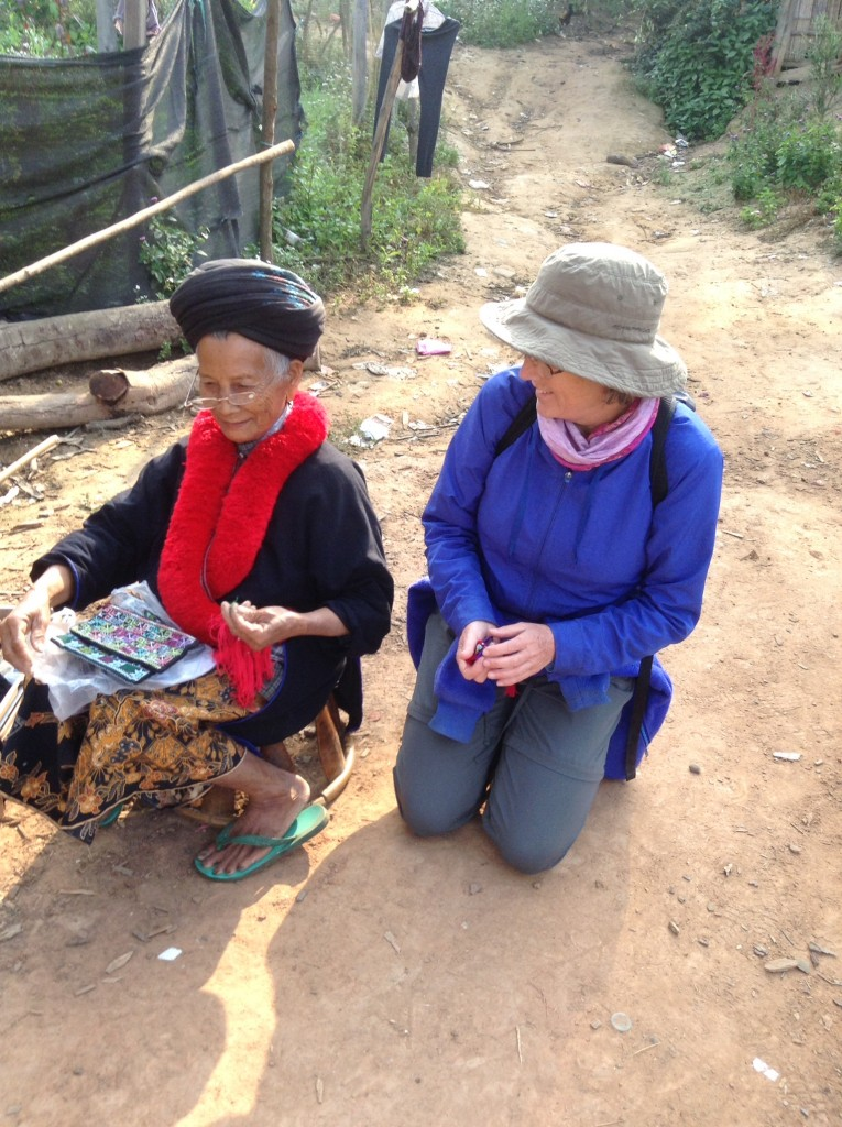 Denise buying some local weaving from the ladies.