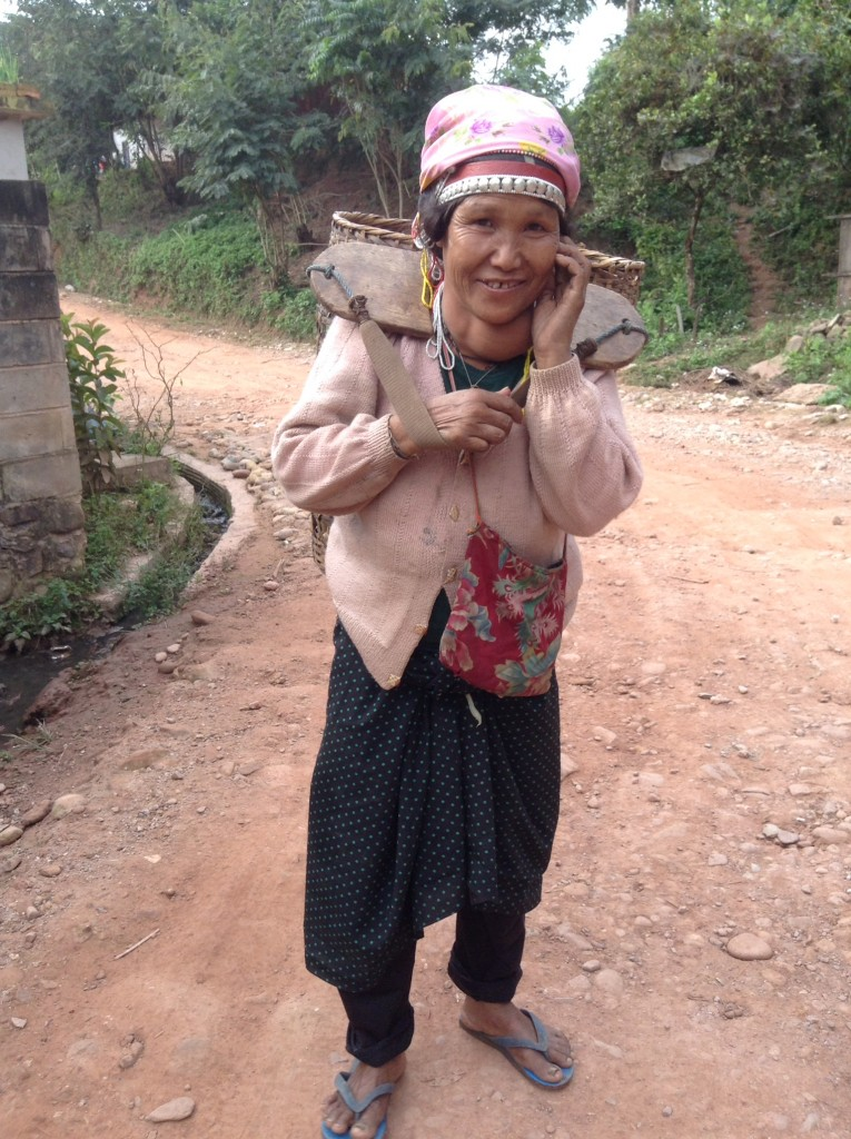A woman taking her sweet potatoes to market.