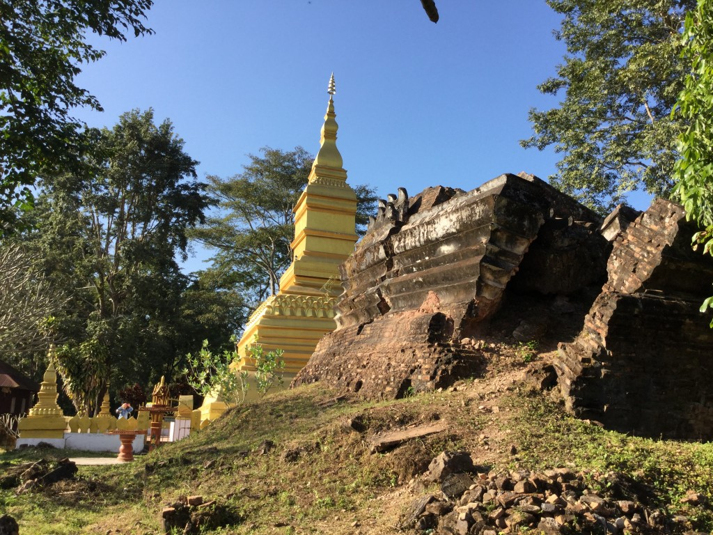 "Stupas at That Phum Phuk. The older stupa, destroyed during the ""secret"" war, is in the foreground."