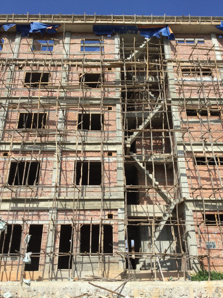 Building under construction in Phonsavan. Scaffolding like this is typical all over Laos.