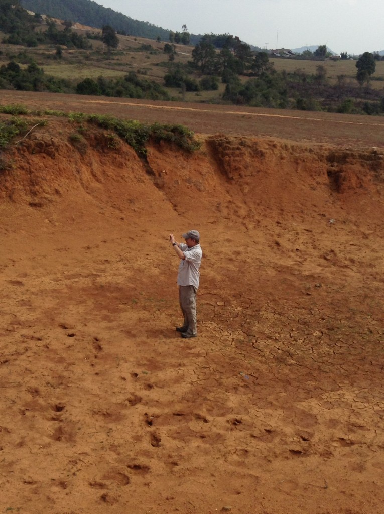 Pete standing inside one of the craters. It had been cleared of UXO according to our guide!