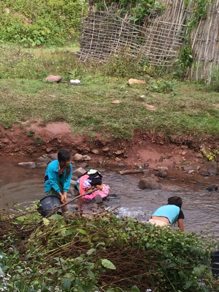 Village girls doing the laundry.
