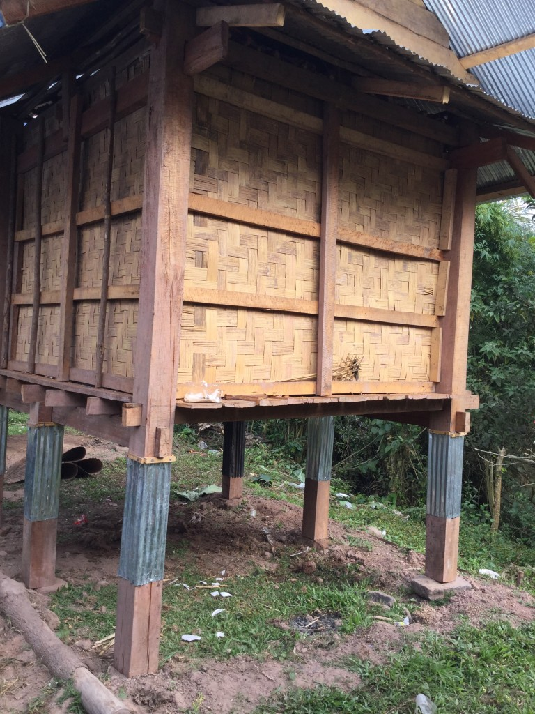 Food storage. Villagers kep their food stores separate from their houses so that if the house burns down from their open fire pits their food is not destroyed. Metal sheathing on the pilings is designed to keep out rats and other rodents.