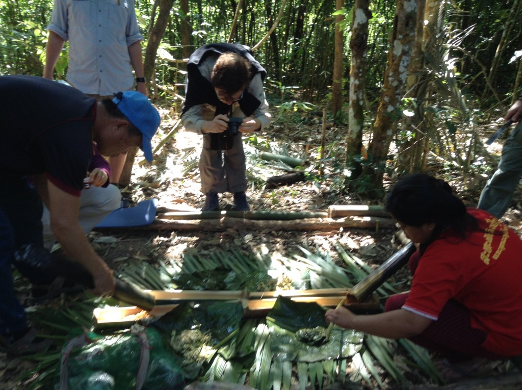Our lunch preparation on our lunch stop. We used bananna leaves for a table and the food was prepared using bamboo as the cooking pot.