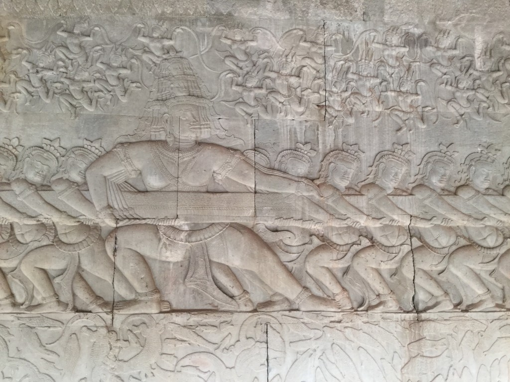 Some incredible inscriptions on the inside walls of Angkor Wat depicting heaven, earth, and hell along with the struggle on earth between good and evil.