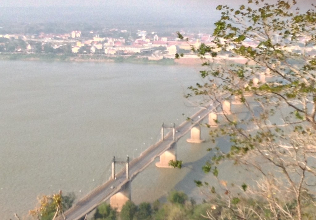 View of Pakse from Buddha's perspective. Had to walk accross the bridge but took a tuk-tuk to the bridge. It is one kilometer long across the Mekong.