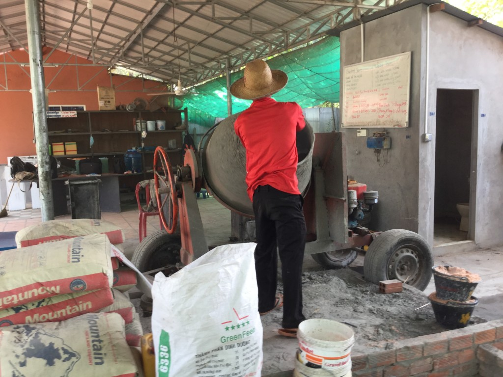 Making cement to make the foundation of the filter.