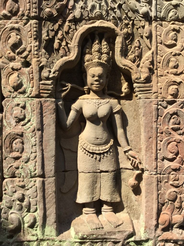 Intricate carvings abound in most temples. We saw at least a hundred of these female figures.