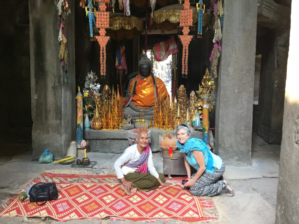 Denise gets a blessing from a monk in one of the od wats.