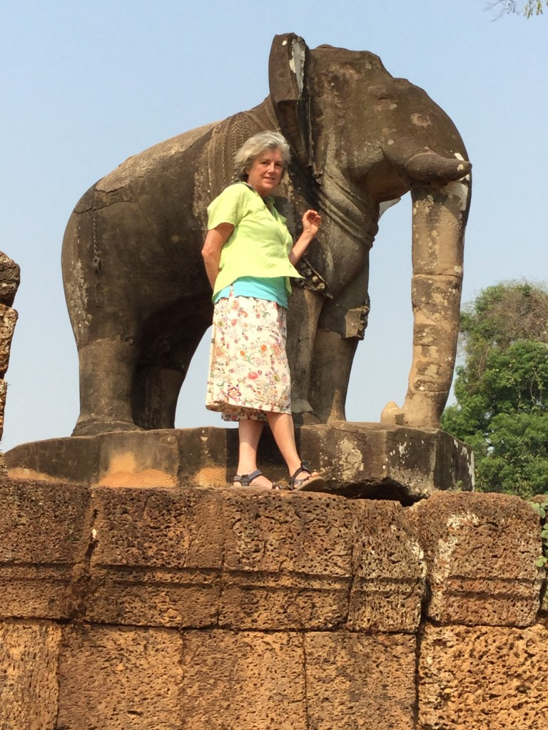 Denise stands next to an elephant that guards each corner of the museum.